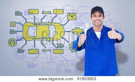 Happy mechanic holding spanner against grey vignette
