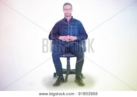 Stern businessman sitting on an office chair against digitally generated server room with towers
