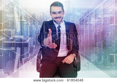 Smiling businessman on an chair office offering handshake against server room with towers