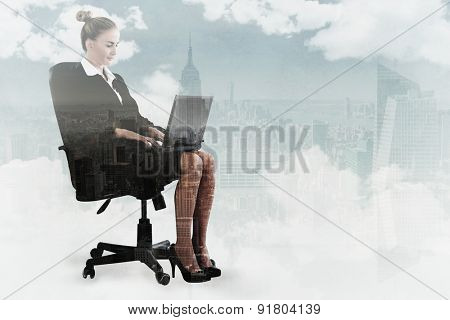 Businesswoman sitting on swivel chair with laptop against new york