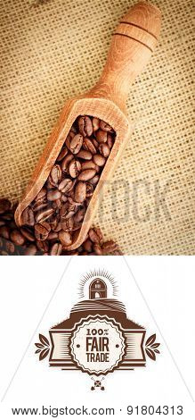 Fair Trade graphic against wooden shovel full of coffee beans