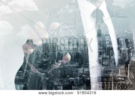 Businessman showing his smartphone screen against new york skyline