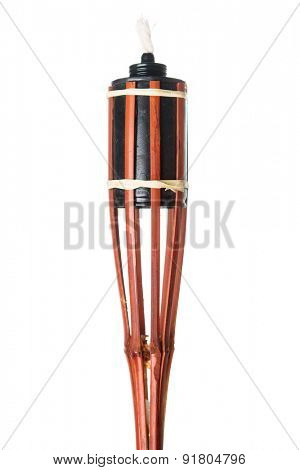 Bamboo torch oil lamp isolated on white background.
