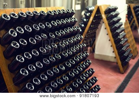 wine bottles in cellar. Selective focus