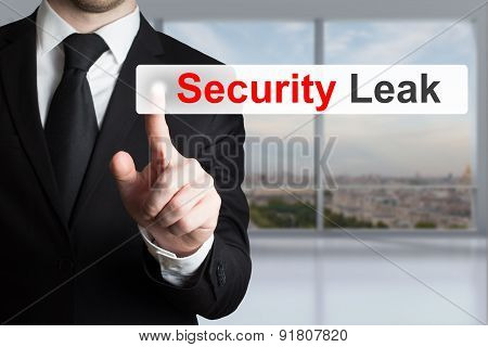Businessman Pushing Touchscreen Security Leak