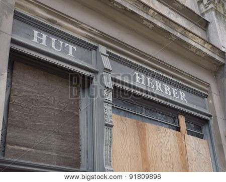 Low Angle View of Closed Shop Exterior with Boarded Up Door and Window Concept Image on Economic Hardship