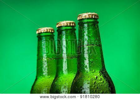 Three Wet Blank Beer Bottles