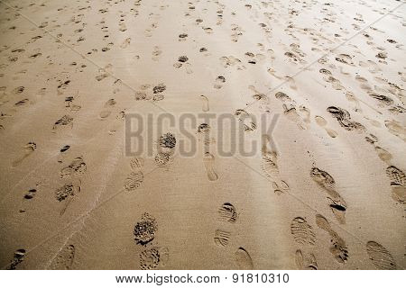 Footprints on sand, selective focus