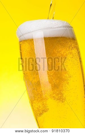 Macro Of Beer Being Pured Into Glass