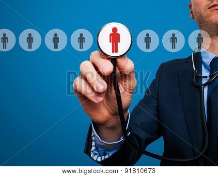 Businessman hand with stethoscope.