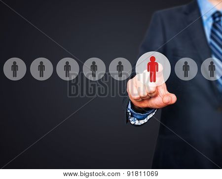 Businessman pressing button on virtual screens.