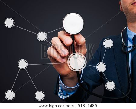 Businessman using stethoscope to diagnose business performance diagram.