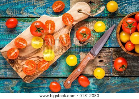 Yellow And Red Cherry Tomatoes Cuted On A Cutting Board