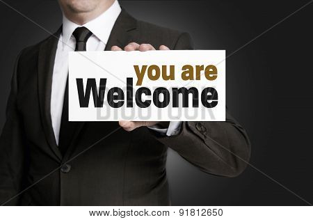 Welcome Sign Is Held By Businessman