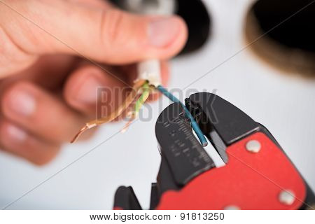 Electrician Hands Stripping Wires