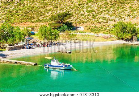 Amazing sea bay on Greek Island with fishing boat