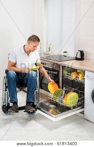 Disabled Man Working In Kitchen