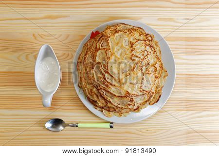 Frying Homemade Pancakes With Sour Cream