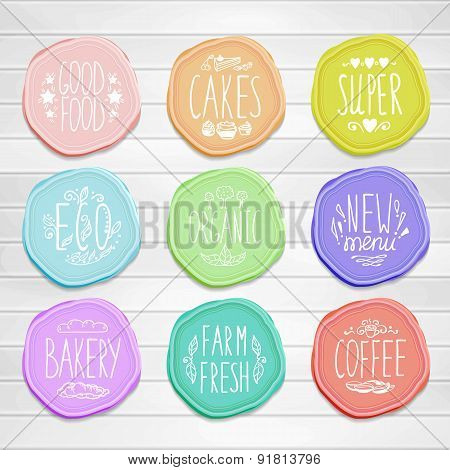 Set Of Retro Badges With Hand-drawn Lettering On A Wood Background.