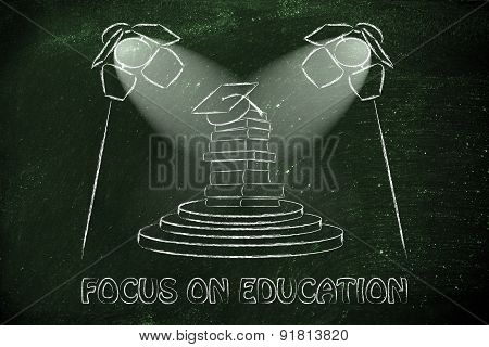 Focus On Education: Pile Of Books With Graduation Cap Under Spotlights