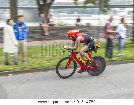 An Athlete Cycles In The Cologne Triathlon