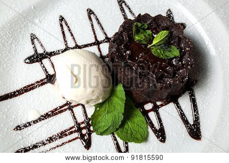 Vanilla ice cream Brownie with mint in dish on table