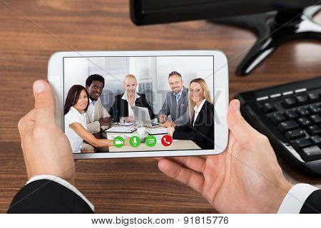 Businessperson Video Conferencing On Mobile Phone