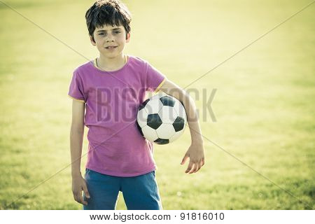 Young girl posing during soccer training
