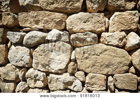 Background created with stone wall of a rural building