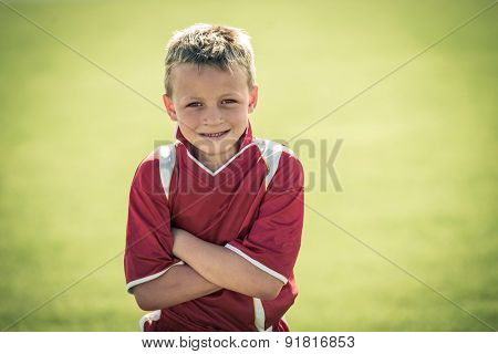 Young soccer player posing for picture, high angle view