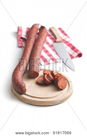 sliced dried sausages on white background