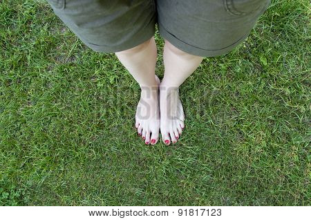 Bare feet in grass background.