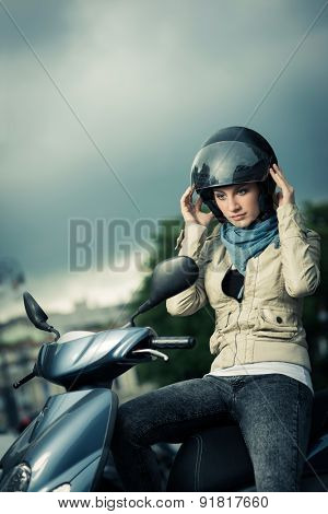 Girl taking on/Off her helmet