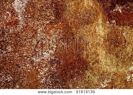 closeup of a yellow and brown rusty surface