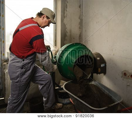 Man Woker Puts A Ready Solution In A Wheelbarrow