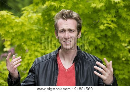 Young Man In Leather Jacket Looking Angry