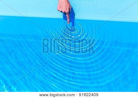 Forefinger making circular waves in swimming pool