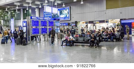 People At The Airport In The Evening