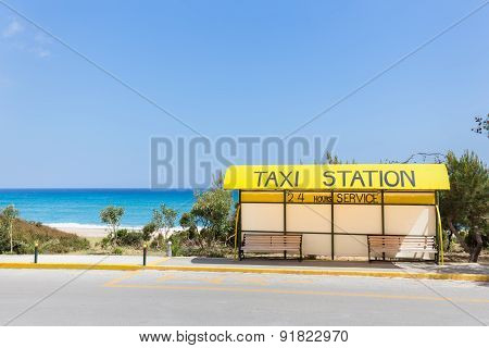 Taxi station near beach and sea in Greece