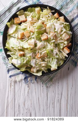 Traditional Caesar Salad On A Plate. Vertical Top View