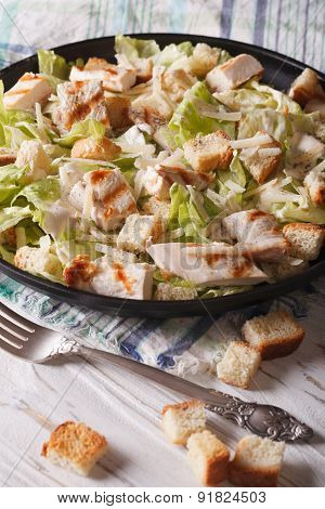 Delicious Caesar Salad With Grilled Chicken Breast Vertical