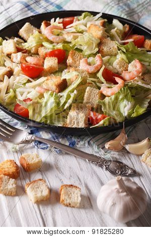 Delicious Caesar Salad With Shrimp Close-up. Vertical
