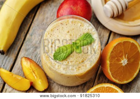 Smoothies With Peaches, Banana And Orange