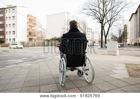 Disabled Man On Wheelchair Looking At Street