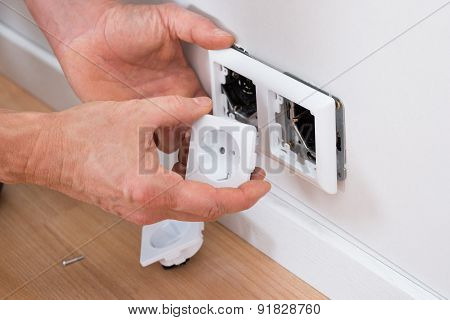 Technician Fixing Socket