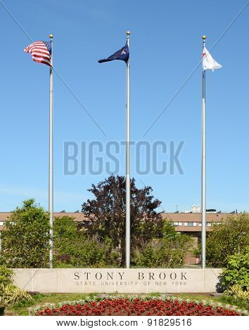 STONY BROOK, NY - MAY 24, 2015: Stony Brook University Main Entrance. The flags at the SUNY institution at Stony Brook, Long Island, New York.