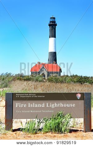 FIRE ISLAND, NY - MAY 23, 2015: Fire Island Lighthouse and National Park Service sign, on Fire Island National Seashore, Long Island, New York.