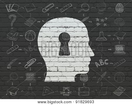 Studying concept: Head With Keyhole on wall background