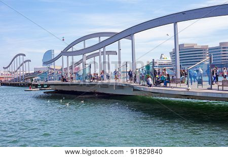 BARCELONA, SPAIN - APRIL, 2015: People strolling on bridge Rambla de mar in Barcelona