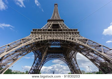 The Eiffel Tower and Montparnasse tower over blue sky